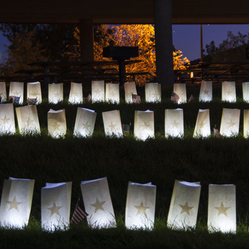 luminaries lit in a community park